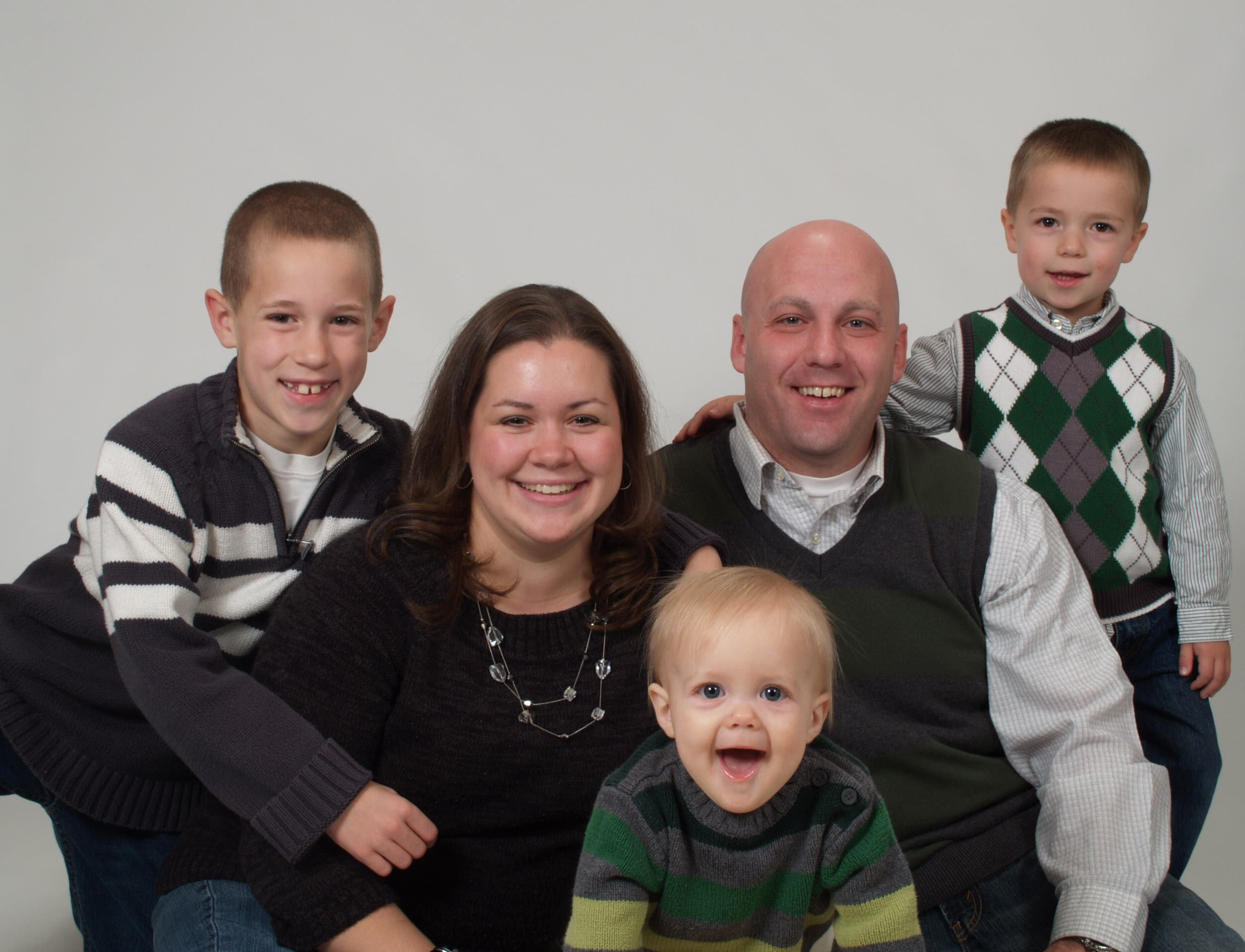 This is a photo of our pastors, Brad and Lynnsey Klooster and their three boys.